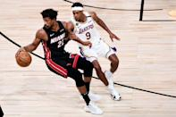 Los Angeles reserve guard Rajon Rondo defends Miami's Jimmy Butler in the Lakers' championship-clinching victory over the Heat in game six of the NBA Finals