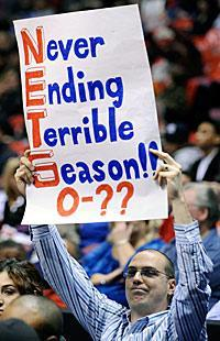 An unidentified fan holds a sign during the fourth quarter of the Nets' game against the Mavericks