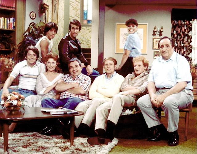 The <em>Happy Days</em> cast at the height of fame: Scott Baio, Henry Winkler, Erin Moran, Anson Williams, Marion Ross, Tom Bosley, Ron Howard, Donny Most, and Al Molinaro. (Photo: Paramount/Everett Collection)