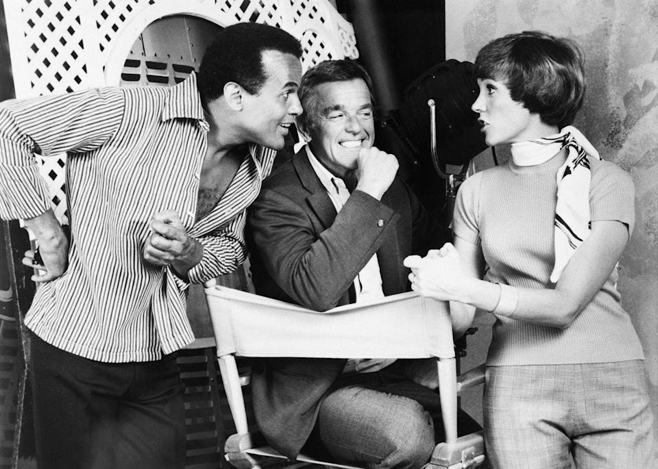 <p>Julie Andrews chats with Harry Belafonte and Gower Champion behind the scenes of her 1969 television special. </p>