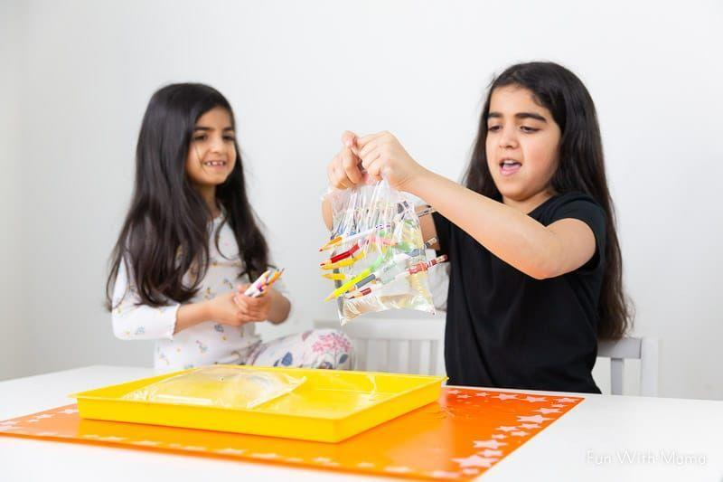"""<p>Kids might guess that if you pierce a bag of water with a sharpened pencil, the water would all leak out. In fact, if you do it right, the polymers of the bag's plastic will re-seal around the pencil, and your counters will stay dry (and your kids will be amazed). You can get them thinking about the chemical compositions that make up everyday items. </p><p><em><a href=""""https://www.funwithmama.com/water-in-a-bag-pencil-experiment-water-experiment-for-kids/"""" rel=""""nofollow noopener"""" target=""""_blank"""" data-ylk=""""slk:Get the tutorial at Fun With Mama »"""" class=""""link rapid-noclick-resp"""">Get the tutorial at Fun With Mama »</a></em></p>"""