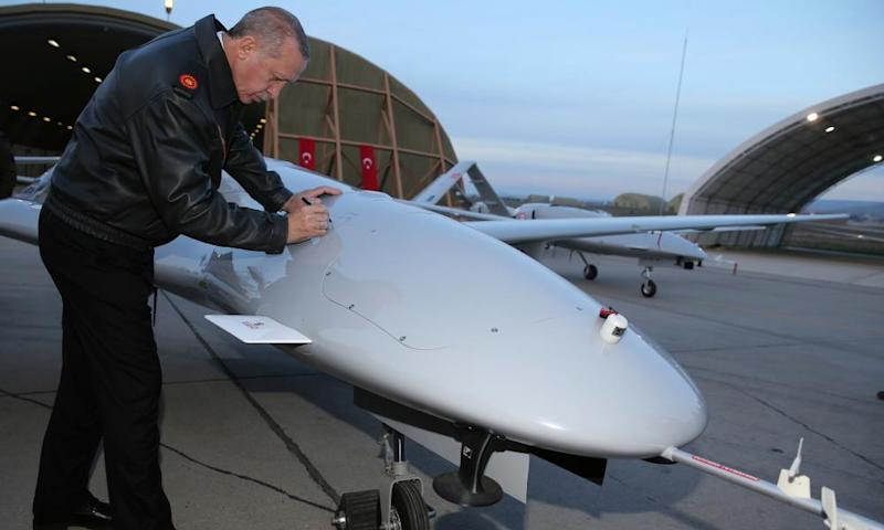 Turkish president Recep Tayyip Erdogan signs a drone. Turkey is now one of the leading makers of lethal drones.