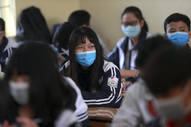 Students wear masks in during a class session at Dinh Cong secondary school in Hanoi, Vietnam on Friday, Jan. 31, 2020. The authorities have advised students to wear masks to school, a day after Vietnam confirmed three more cases of the new virus. (AP Photo/Hau Dinh)