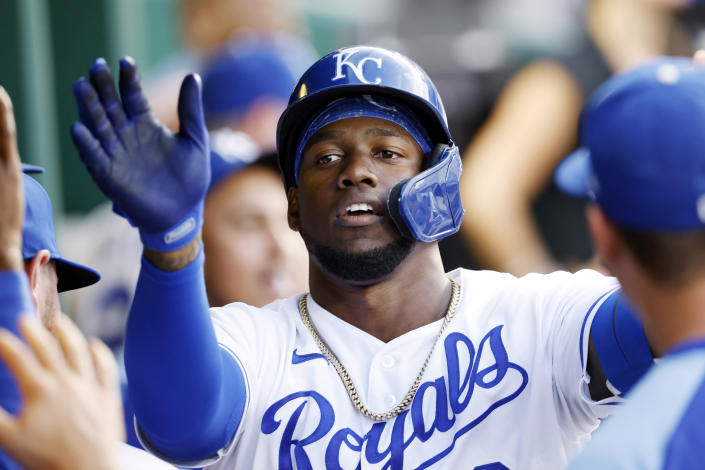 Kansas City Royals' Jorge Soler celebrates in the dugout after hitting a solo home run in the fourth inning of a baseball game against the Chicago White Sox at Kauffman Stadium in Kansas City, Mo., Monday, July 26, 2021. (AP Photo/Colin E. Braley)