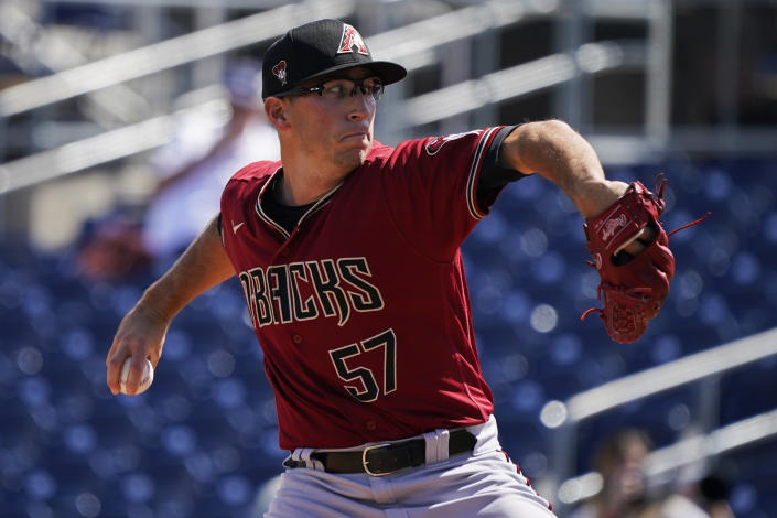 Arizona Diamondbacks' Taylor Widener pitches in the first inning of a spring training baseball game against the Seattle Mariners, Monday, March 15, 2021, in Surprise, Ariz. (AP Photo/Sue Ogrocki)
