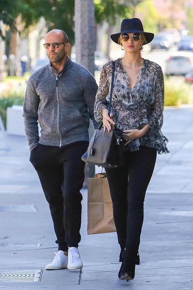 <p>Pregnant model Rosie Huntington-Whiteley matched with her partner, actor Jason Statham, in West Hollywood in April. (Photo: AKM-GSI)<br><br></p>