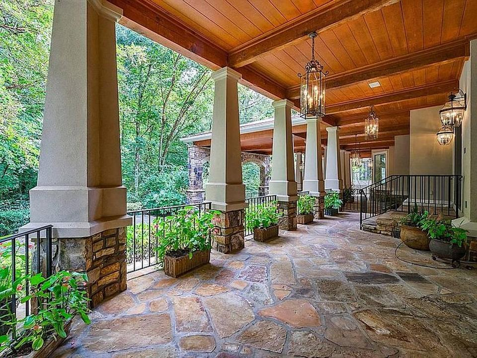 Jeff Foxworthy's old mansion includes a terrace with oversize lanterns and reclaimed wood beams from the Hershey Factory in Pennsylvania.
