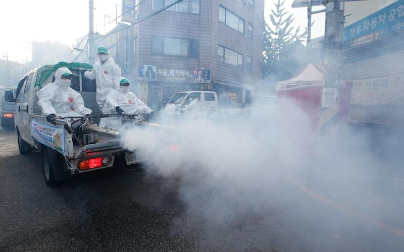 A fumigator truck spray fumigation and disinfect a street in Seoul - KIM HEE-CHUL/EPA-EFE/Shutterstock