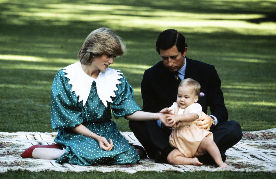 Diana, Charles and Prince William on the lawn of Government House in Auckland, New Zealand in 1983 during the Royal Tour of New Zealand. (David Levenson/Getty Images)