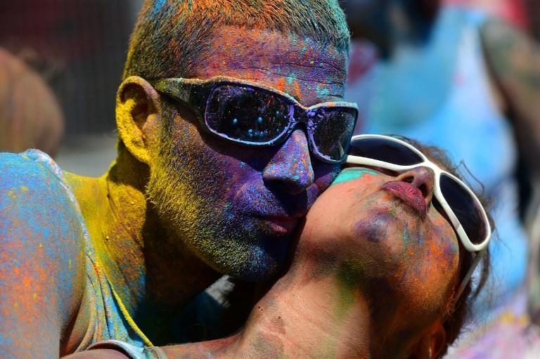 <p>Barcelona: Two participants with coloured powder on the body take part in a Holi Party in Barcelona. </p>