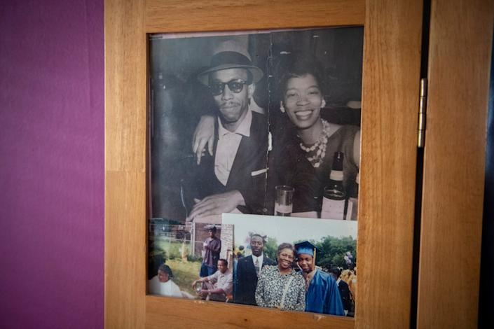 Photos of Charles and Osie Frazier are prominently displayed sit on display in a screen in the Frazier family home in Chicago.