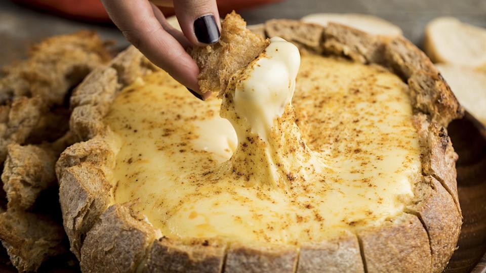 """<p>If you've gotten really into <a href=""""https://www.thedailymeal.com/how-to-bake-bread-at-home?referrer=yahoo&category=beauty_food&include_utm=1&utm_medium=referral&utm_source=yahoo&utm_campaign=feed"""" rel=""""nofollow noopener"""" target=""""_blank"""" data-ylk=""""slk:making sourdough this year"""" class=""""link rapid-noclick-resp"""">making sourdough this year</a> but are looking for creative ways to serve it, use a big ol' loaf as a vessel for ooey, gooey baked brie.</p> <p><a href=""""https://www.thedailymeal.com/recipes/baked-brie-bowl-recipe?referrer=yahoo&category=beauty_food&include_utm=1&utm_medium=referral&utm_source=yahoo&utm_campaign=feed"""" rel=""""nofollow noopener"""" target=""""_blank"""" data-ylk=""""slk:For the Baked Brie Bowl recipe, click here."""" class=""""link rapid-noclick-resp"""">For the Baked Brie Bowl recipe, click here.</a></p>"""