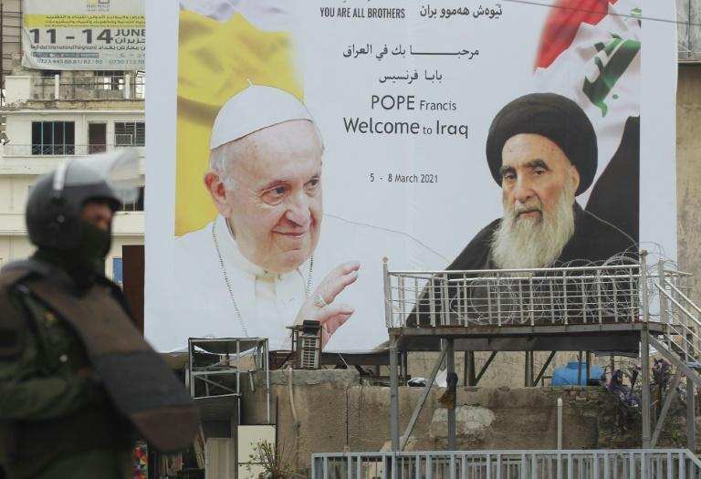 A billboard celebrates the meeting between Pope Francis and Grand Ayatollah Ali Sistani on the second day of the pontiff's historic visit to Iraq