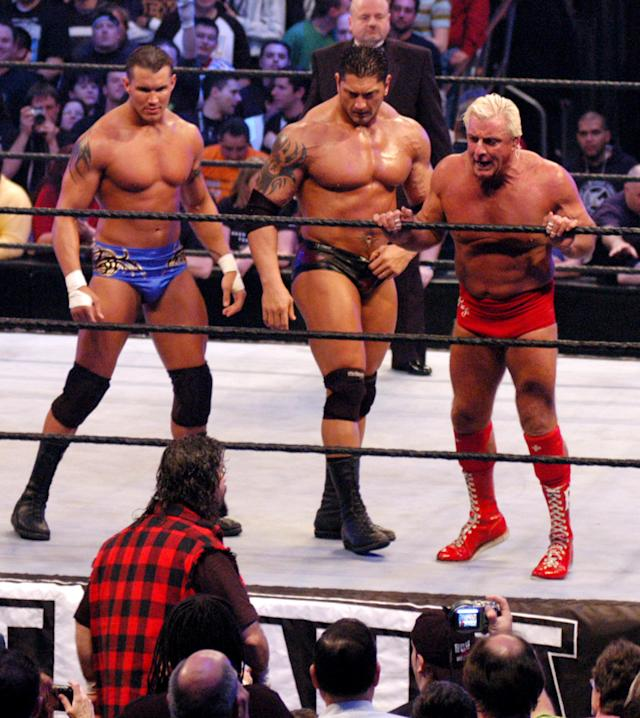 <p>Mick Foley, Randy Orton, Batista and Ric Flair in action during a wrestling event. (Photo by Djamilla Rosa Cochran/WireImage) </p>