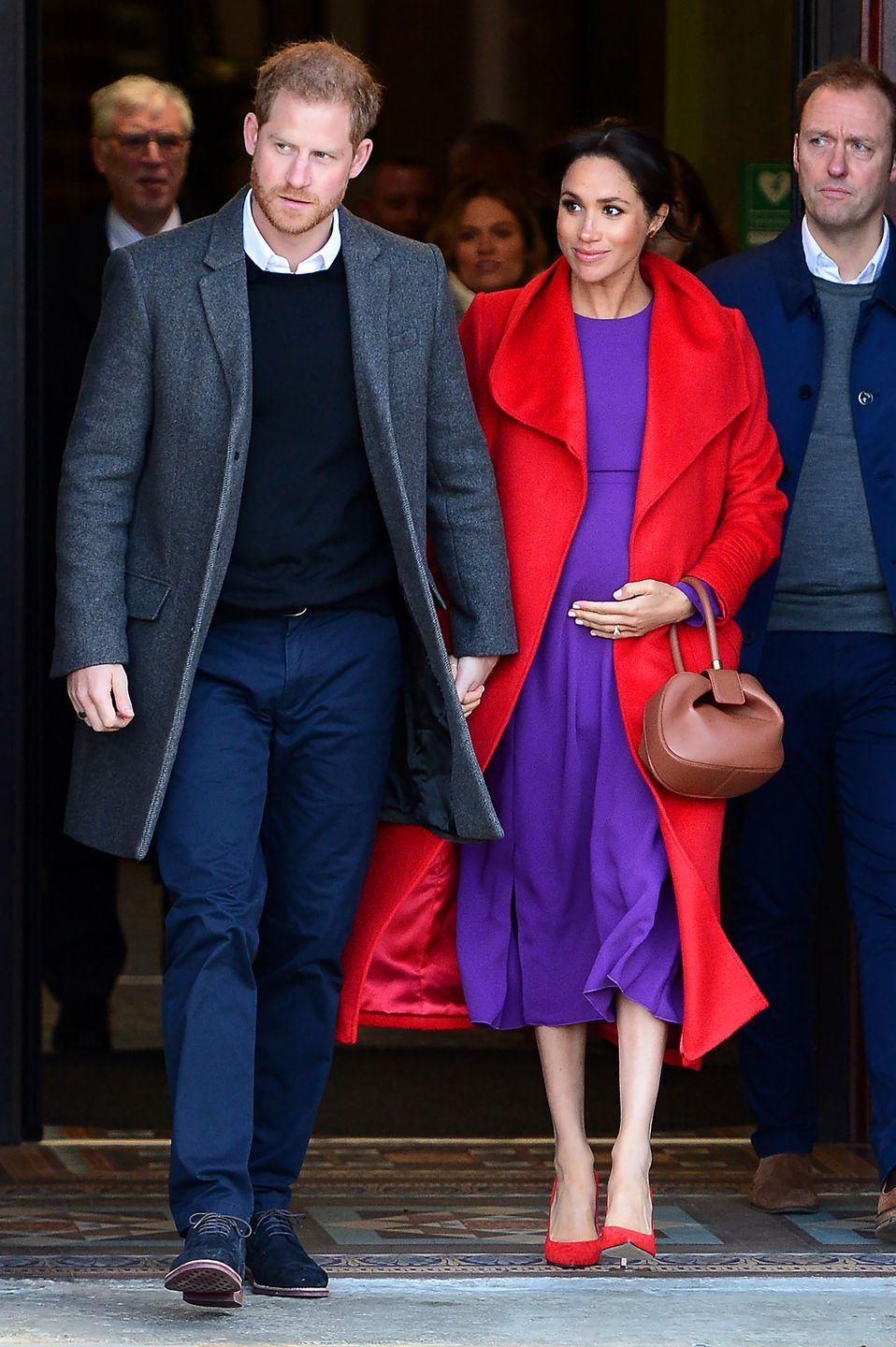 <p>Prince Harry leaves Birkenhead Town Hall with Meghan Markle. </p>