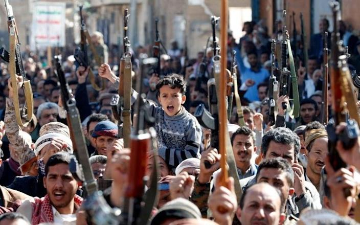A young boy among the armed crowd in Sana'a.CREDIT: YAHYA ARHAB/EPA-EFE - YAHYA ARHAB/EPA-EFE
