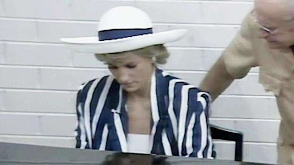 Diana, Princess of Wales (1961 - 1997) plays the piano during a visit to the Music College of the Victorian College of the Arts in Melbourne, Australia, January 1988. She is wearing a black and white striped dress by Roland Klein.
