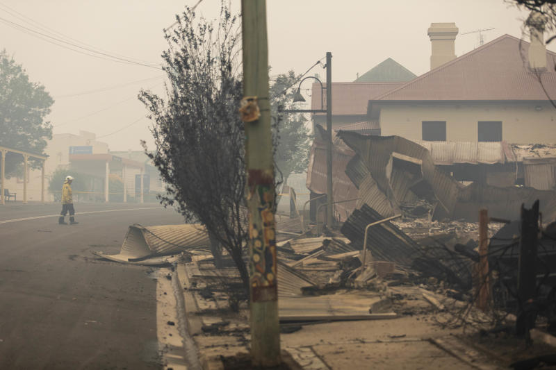 Firefighters inspect fire damage in Cobargo, NSW.