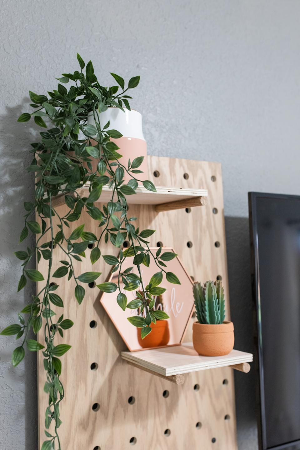 Jaclyn Quinones of Crazy Life With Littles shows how to DIY a home office with pegboard shelf.
