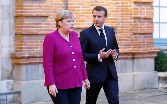 French president Emmanuel Macron, right, and German chancellor Angela Merkel in Toulouse, France. Photo: Regis Duvignau/Reuters