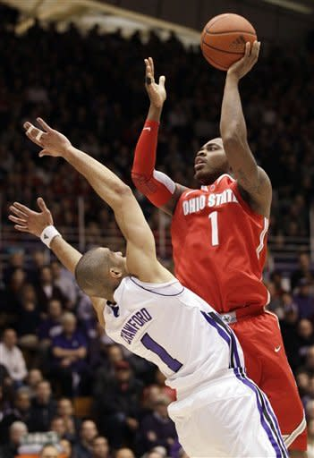 Ohio State forward DeShaun Thomas, rightgoes up for a shot against Northwestern forward Drew Crawford, left, during the first half of an NCAA college basketball game in Evanston, Ill., Wednesday, Feb. 29, 2012. (AP Photo/Nam Y. Huh)