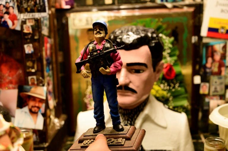 A statue of Guzman is displayed for sale near a bust of narco-saint Jesus Malverde, in Culiacan, Sinaloa state in northwest Mexico (AFP Photo/Pedro PARDO)