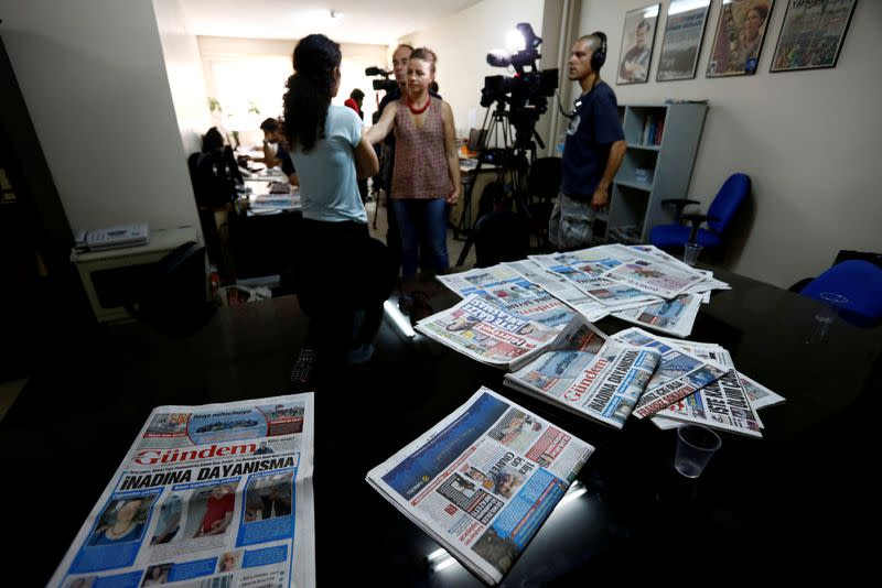 FILE PHOTO: A journalist of pro-Kurdish Ozgur Gundem gives an interview to a German TV channel at their newsroom before a protest against the arrest of three prominent campaigners for press freedom, in front of the pro-Kurdish Ozgur Gundem newspaper in Ist