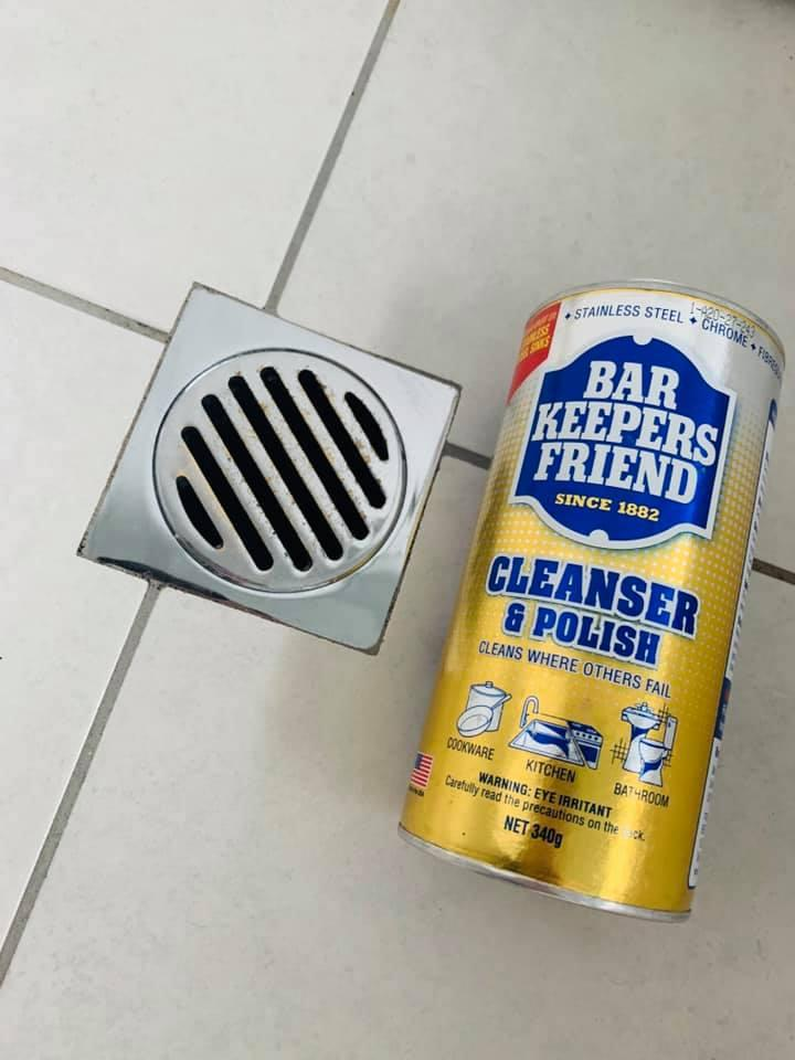 Clean shower drain next to Bar Keepers Friend Cleanser and Polish in transformation