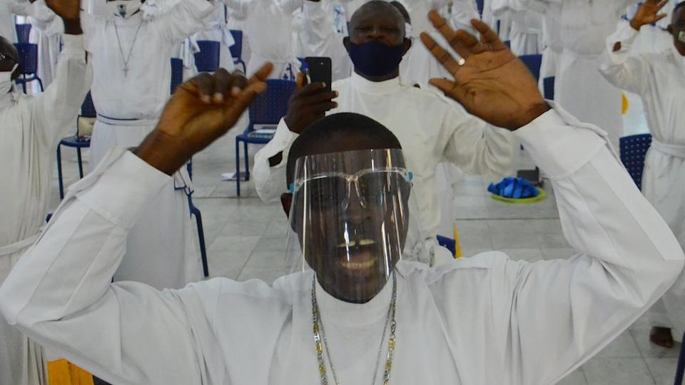 Worshippers wearing facemask sings as worship centers reopen after the COVID-19 lockdown, at the Celesitail Church of Christ, Arch Diocese National Headquarter Makoko, Lagos, as measures against the spread of COVID-19 Coronavirus in Lagos, Nigeria on August 8, 2020