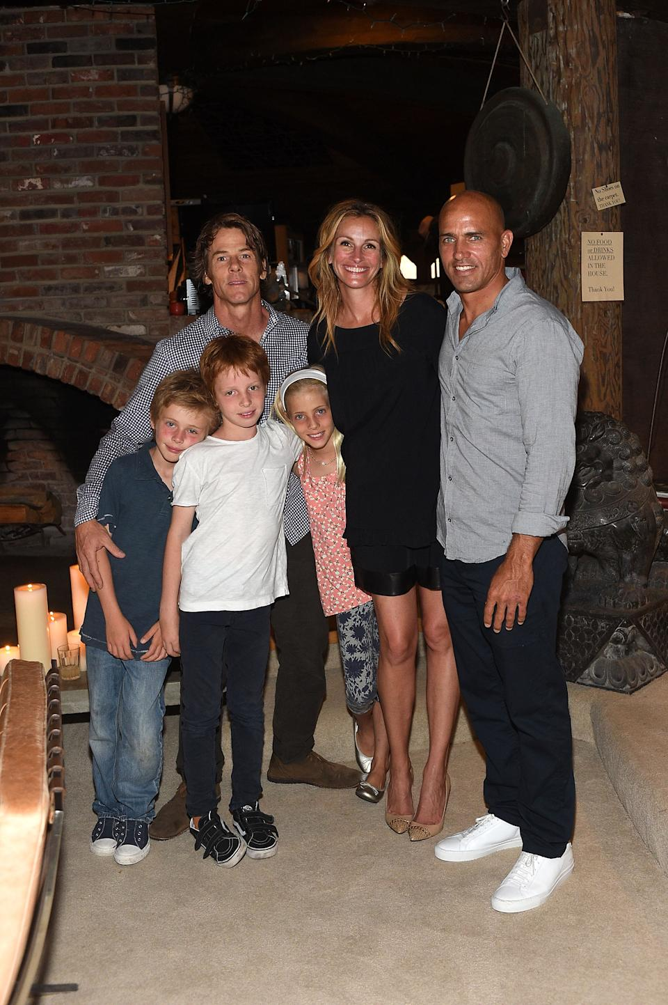 Daniel Moder, Julia Roberts, Kelly Slater, Phinnaeus Moder, Henry Daniel Moder and Hazel Moder attend Kelly Slater, John Moore and Friends Celebrate the Launch of Outerknown at Private Residence on August 29, 2015 in Malibu, California
