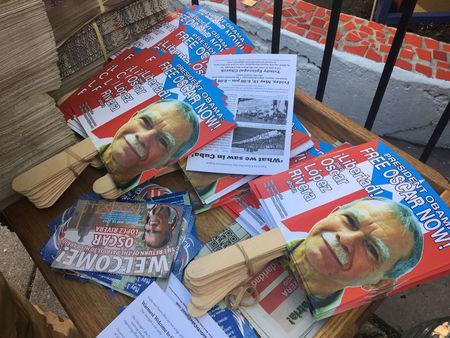 FILE PHOTO - Placards bearing the image of Oscar Lopez Rivera are seen readied for a party, after his release from house arrest in Puerto Rico, ahead of his return to Chicago, Illinois, U.S. on May 18, 2017.  REUTERS/Timothy McLaughlin/File Photo