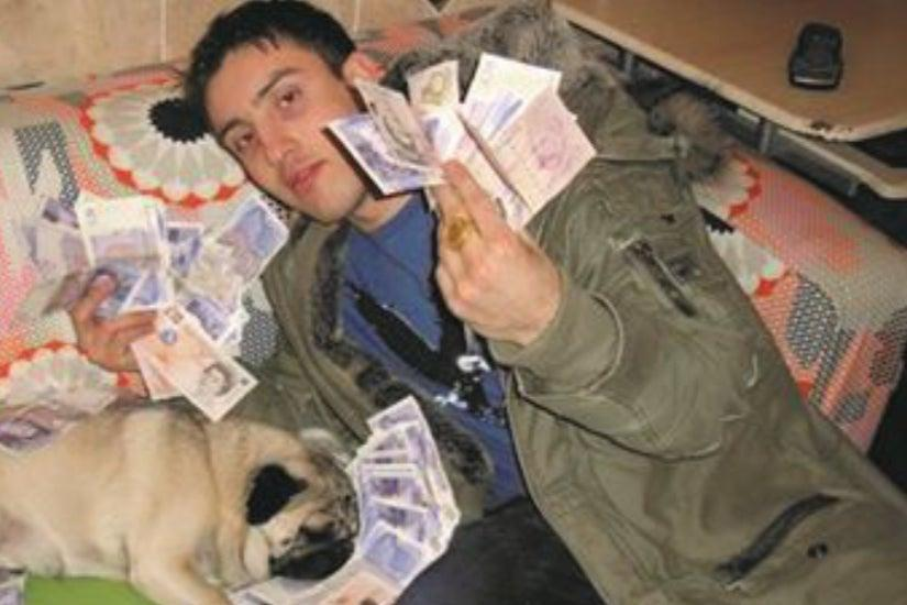 Kevin Heartbreak posing with cash and his pet dog (City of London Police)