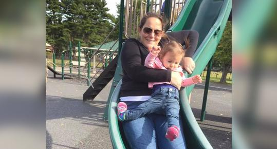 Photo captures moment toddler's leg broke while on slide with mom