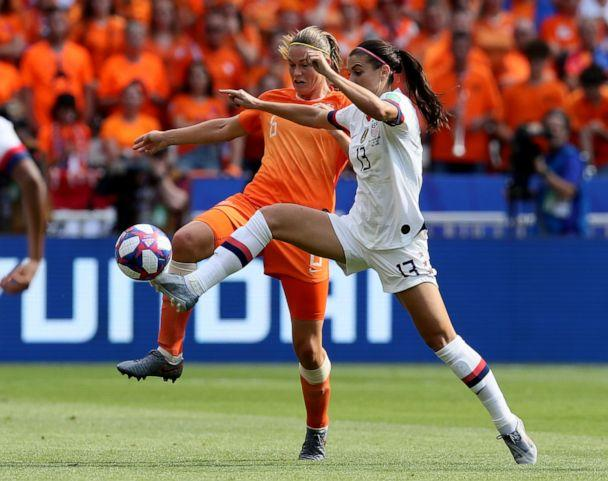 PHOTO: Netherlands' Anouk Dekker, left, fights for the ball with United States' Alex Morgan during the Women's World Cup final soccer match between US and The Netherlands at the Stade de Lyon in Decines, outside Lyon, France, July 7, 2019. (David Vincent/AP)