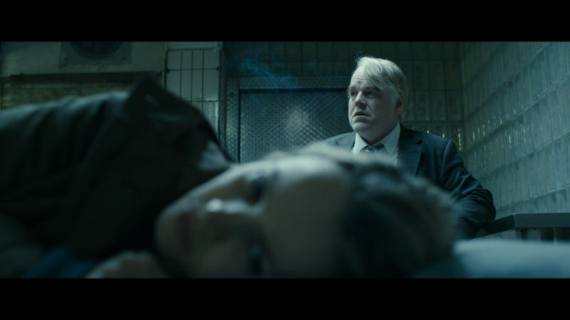 "This photo provided courtesy of the Sundance Institute shows Philip Seymour Hoffman, rear, and Rachel McAdams, in the film, ""A Most Wanted Man,"" directed by Anton Corbijn. The film stars Hoffman, Rachel McAdams, Willem Dafoe and Robin Wright, and is a modern-day thriller based on a John le Carre bestseller. The film premieres at the 2014 Sundance Film Festival, which runs Jan. 16 - 26, 2014, in Park City, Utah. (AP Photo/Sundance Institute)"
