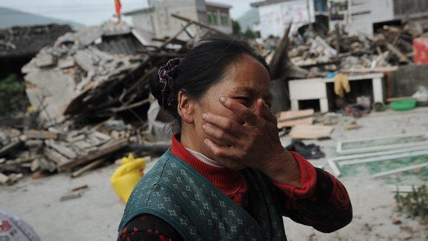 <p>Luo Shiqiang sat near chunks of concrete, bricks and a ripped orange sofa and told how his grandfather was just returning from feeding chickens when their house collapsed and crushed him to death in this weekend's powerful earthquake in southwestern China.</p>