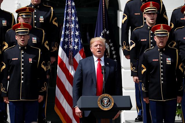 "U.S. President Donald Trump sings along with members of the United States Army Chorus at his ""celebration of America"" event on the South Lawn of the White House in Washington, U.S., June 5, 2018. The event was arranged after Trump canceled the planned visit of the Super Bowl champion Philadelphia Eagles to the White House. REUTERS/Kevin Lamarque"