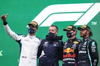 Russell with Verstappen (second right) and Hamilton on the podium (AFP/KENZO TRIBOUILLARD)