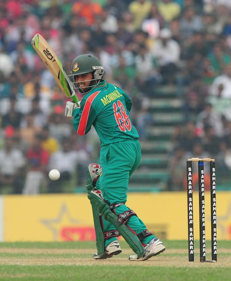 Bangladesh batsman Mominul Haque plays a shot during the third One-Day International (ODI) cricket match between Bangladesh and New Zealand at Khan Jahan Ali Stadium in Fatullah, on the outskirts of Dhaka on November 3, 2013 . AFP PHOTO/ Munir uz ZAMAN        (Photo credit should read MUNIR UZ ZAMAN/AFP/Getty Images)