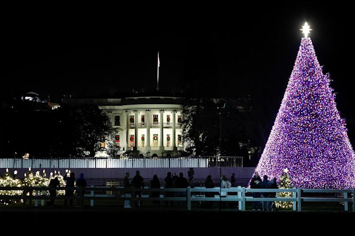 <p>The National Christmas Tree is illuminated outside of the White House.</p> (REUTERS)