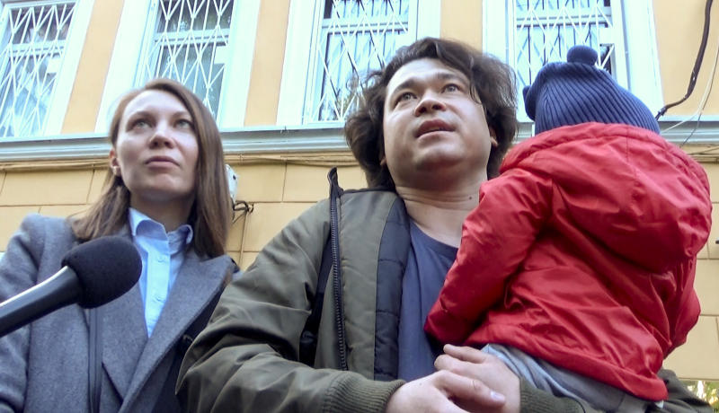 This video grab provided by TV Rain on Tuesday, Aug. 6, 2019, shows Dmitri and Olga Prokazov, parents of a 1-year-old boy speaking to journalists in Moscow, Russia . Moscow's children's rights ombudsman and other public figures have reacted with outrage to Russian prosecutors' moves to remove a 1-year-old boy from his parents because they allegedly took him to an unauthorized protest. (TV RAIN via AP) RUSSIA OUT