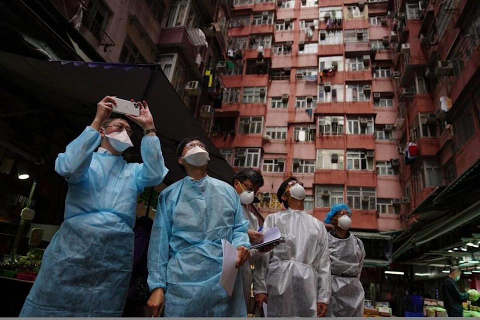 Professor Yuen Kwok-yung inspects Wai Lee Building in Quarry Bay on Monday. Photo: Sam Tsang