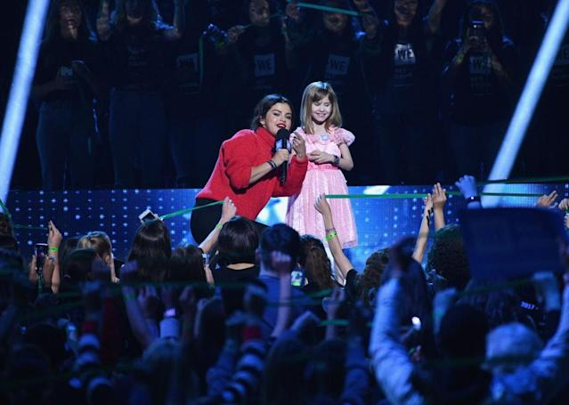 Selena Gomez chats with her new best friend, Nellie Mainor, onstage at WE Day California. (Photo: Allen Berezovsky/FilmMagic)