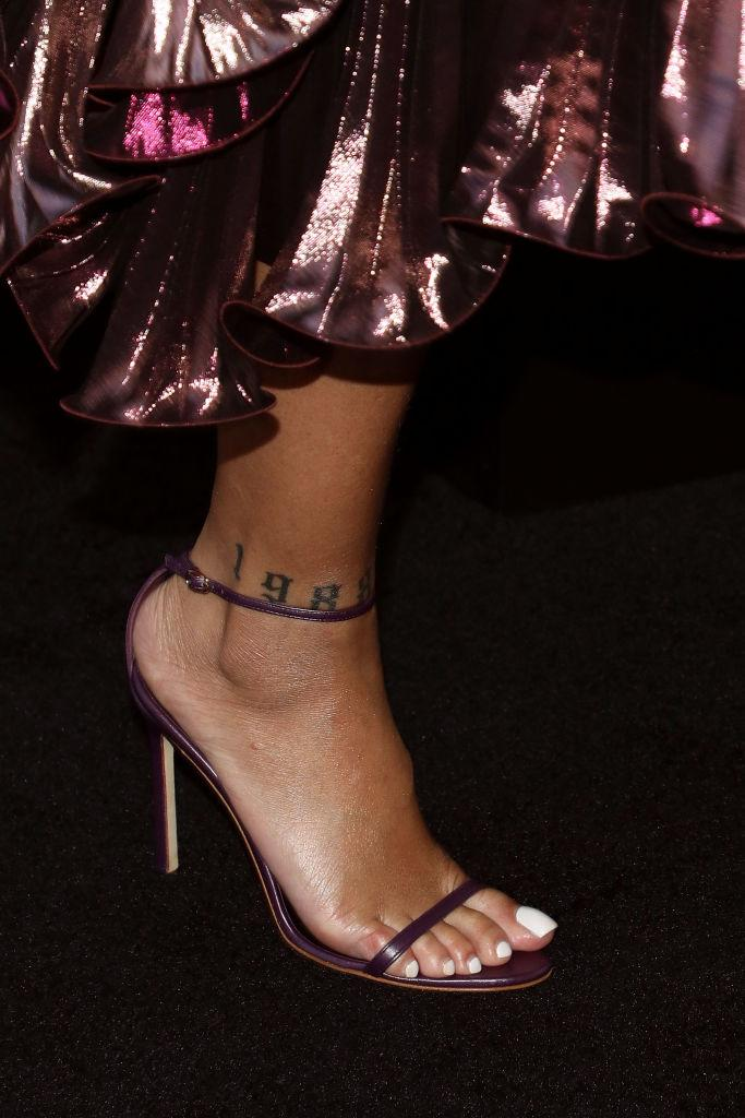 Rihanna has 1988 tattooed on her right foot courtesy of Bang Bang [Photo: Getty]