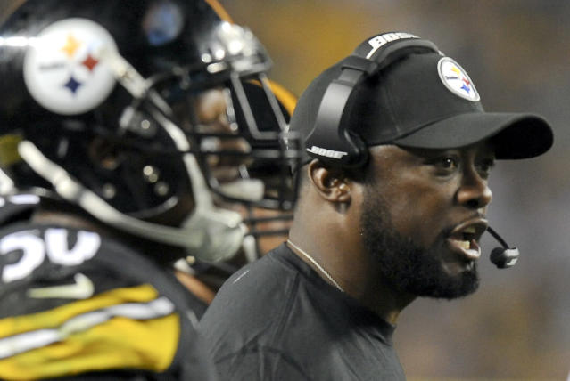 Pittsburgh Steelers head coach Mike Tomlin, right, yells to his players as he watches from the sideline beside outside linebacker Ryan Shazier (50) in the second quarter of a NFL football preseason game against the Buffalo Bills on Saturday, Aug. 16, 2014, in Pittsburgh. (AP Photo/Don Wright)
