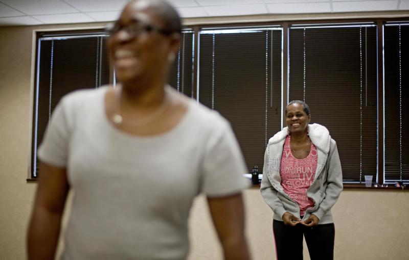 In a Wednesday, April 25, 2012 photo, cancer survivors Hastine Reese, 50, of Stockbridge, Ga., right, and Vivian Cox, 48, of Stone Mountain, Ga., talk after an exercise class, in Atlanta. A cancer diagnosis often inspires people to exercise and eat healthier. Now the experts say there's evidence that that may help the disease from returning. The American Cancer Society on Thursday issued new guidelines urging doctors to talk to their cancer patients about slimming down if they're fat, eating right and doing some exercise. (AP Photo/David Goldman)