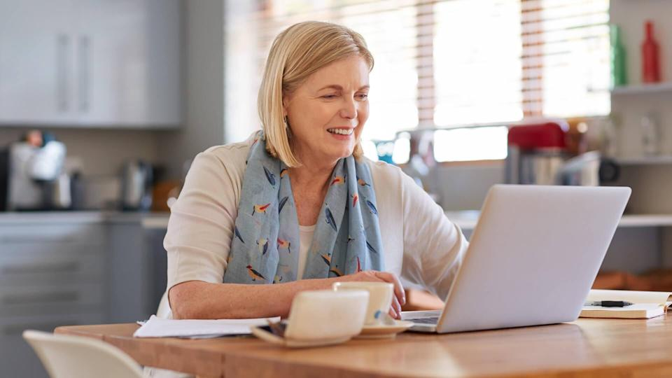 Shot of a mature woman using a laptop to do her finances at homehttp://195.