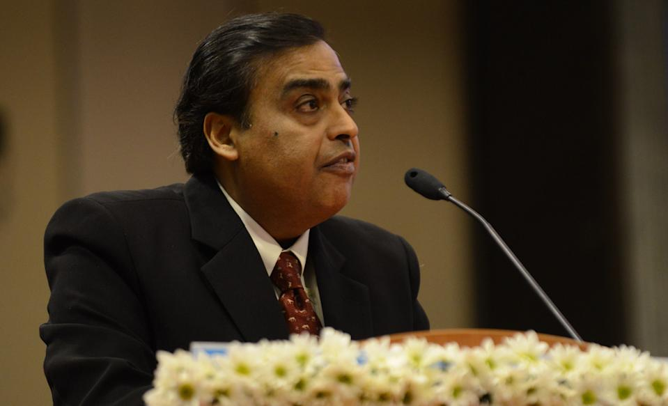 Indian Chairman and Managing Director, Reliance Industries Ltd., Mukesh Ambani, speaks during the launch of Vibrant Gujarat 2013 6th Global Summit at Mahatma Mandir in Gandhinagar, some 30 kms from Ahmedabad on January 11, 2013. The summit is being attended by national and international corporations in large numbers. AFP PHOTO / Sam PANTHAKY