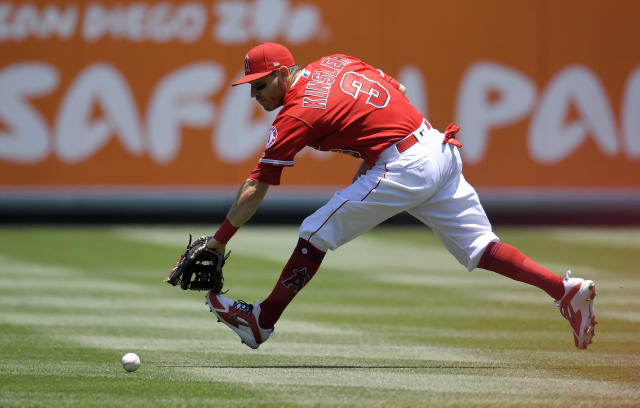 Los Angeles Angels second baseman Ian Kinsler cannot reach a ball hit for a single by Toronto Blue Jays' Yangervis Solarte during the first inning of a baseball game Sunday, June 24, 2018, in Anaheim, Calif. (AP Photo/Mark J. Terrill)