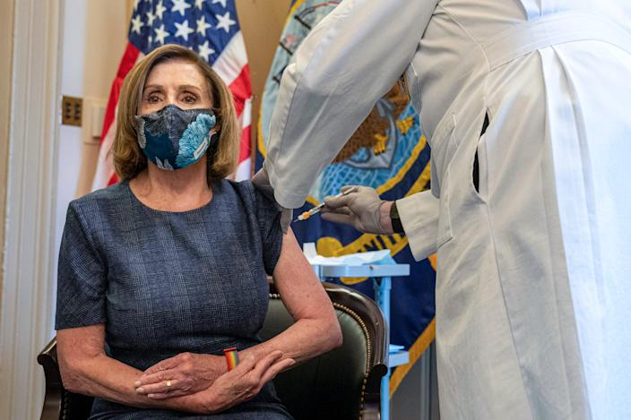 Speaker of the House Nancy Pelosi, D-Calif., receives a Pfizer-BioNTech COVID-19 vaccine shot by Dr. Brian Monahan, attending physician Congress of the United States in Washington on Dec. 18, 2020. The needle is visible in this image; it is not covered by a safety cap.